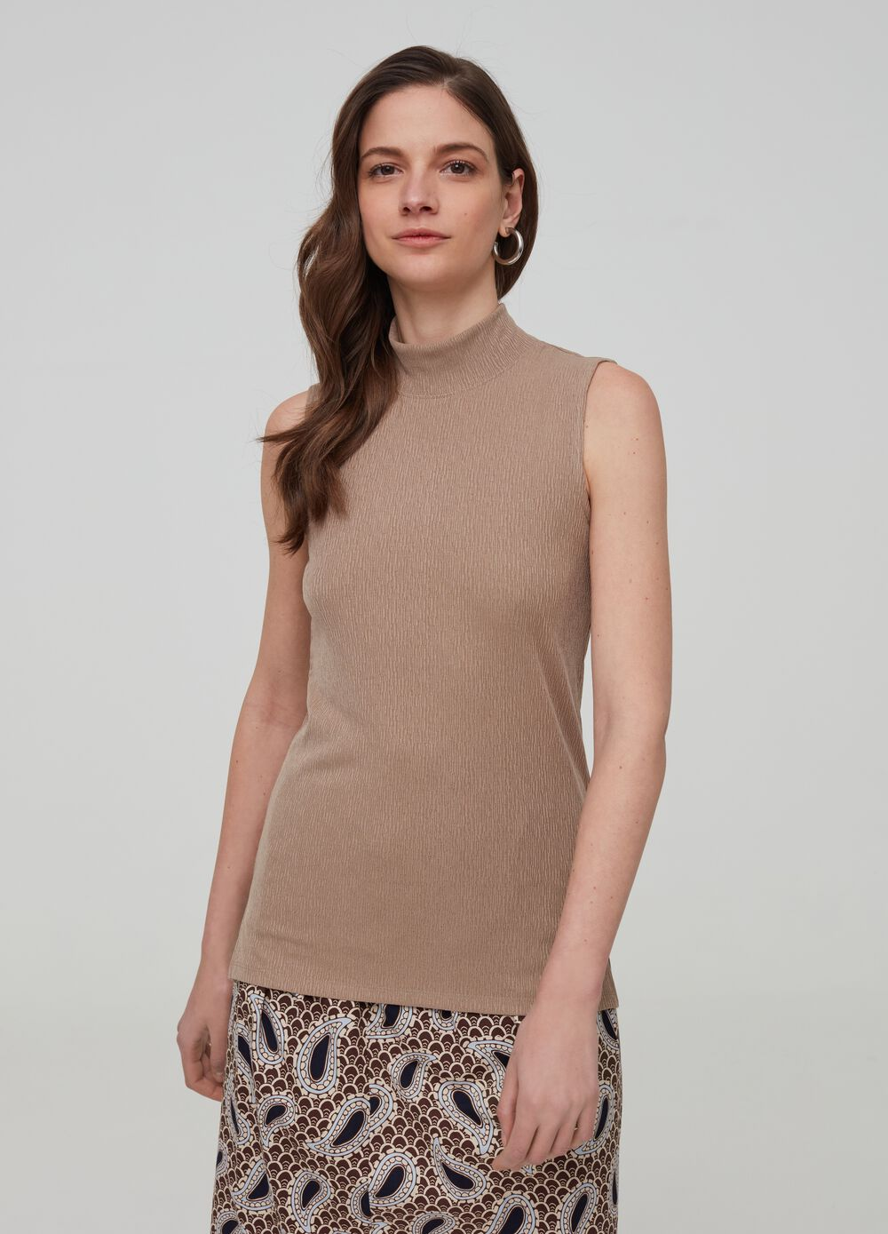 Sleeveless top with high neck
