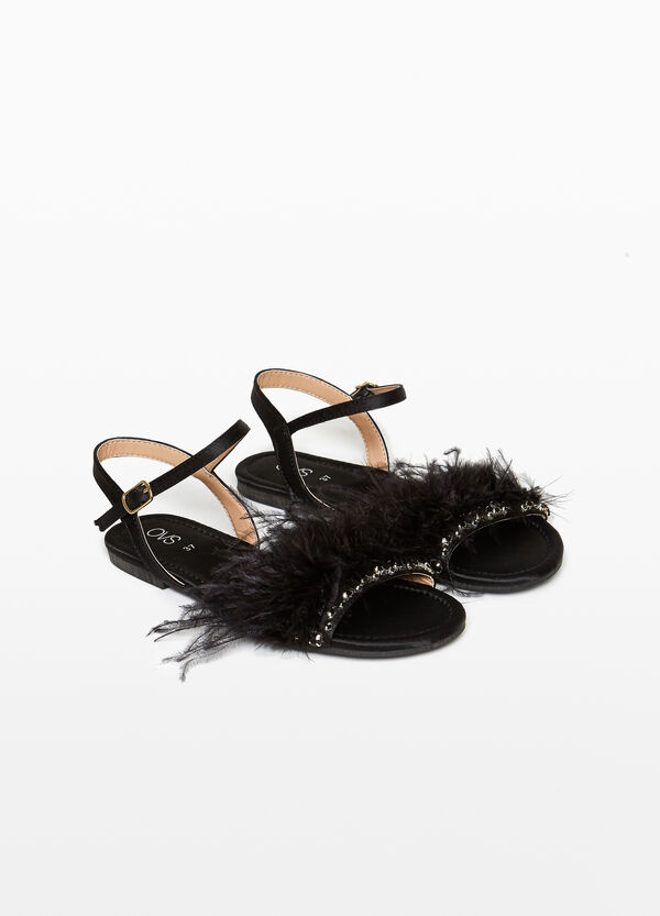 Sandals with feathers and stones