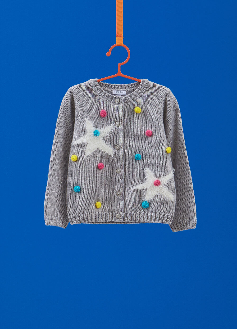 Knitted cardigan with lurex and pompoms