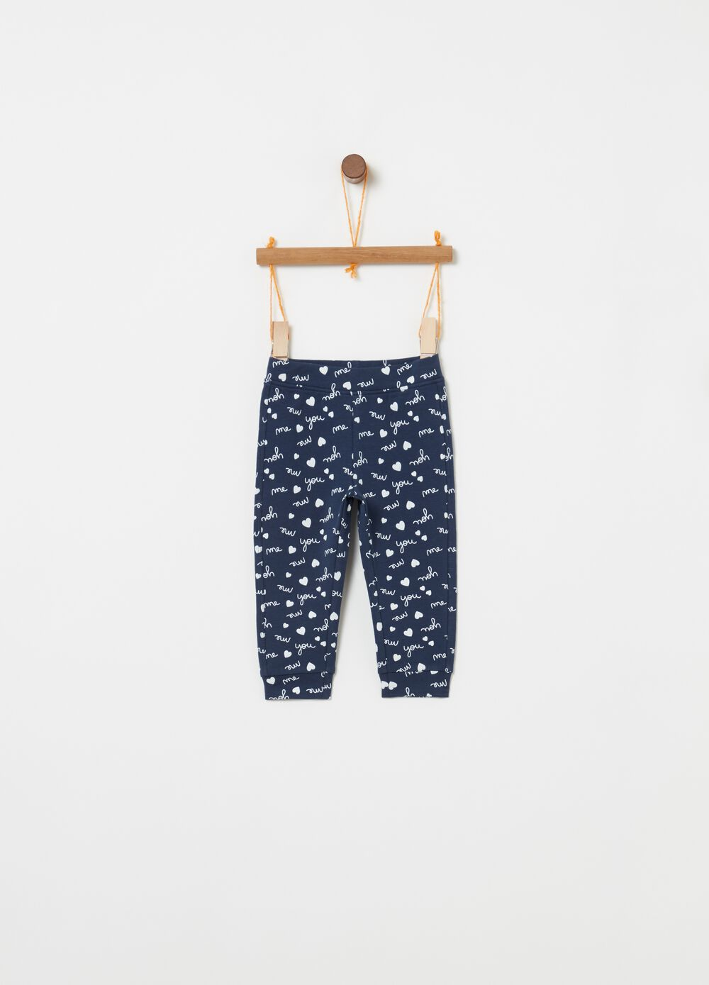 Trousers with lettering and hearts print
