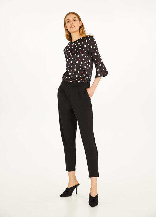 Blouse with three-quarter sleeves and polka dot pattern