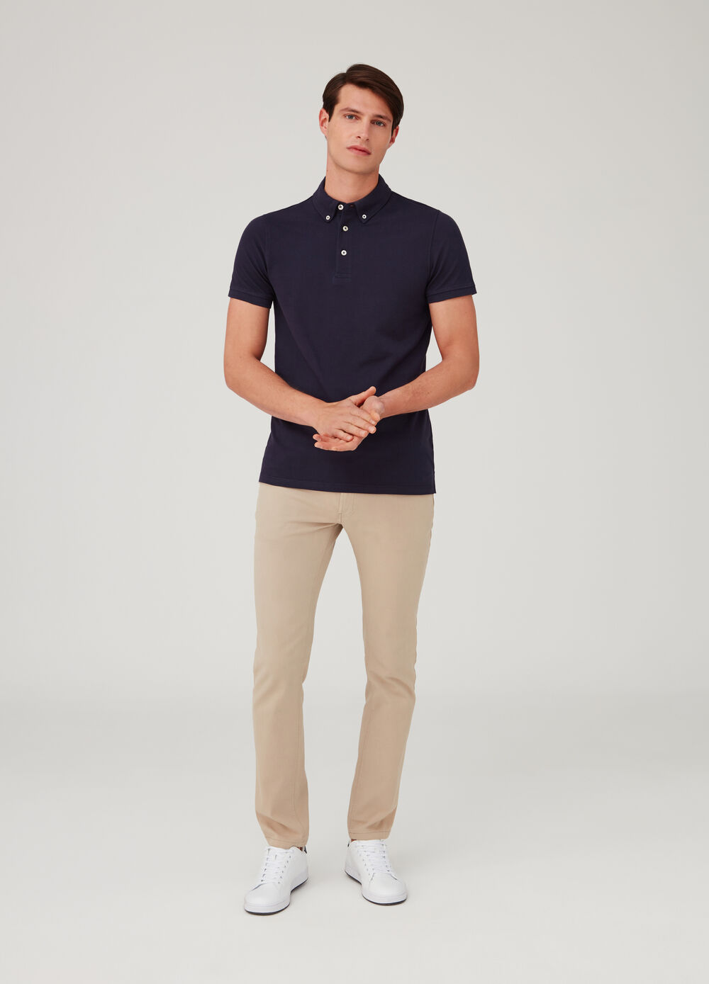 Solid colour piquet polo shirt with button-down collar