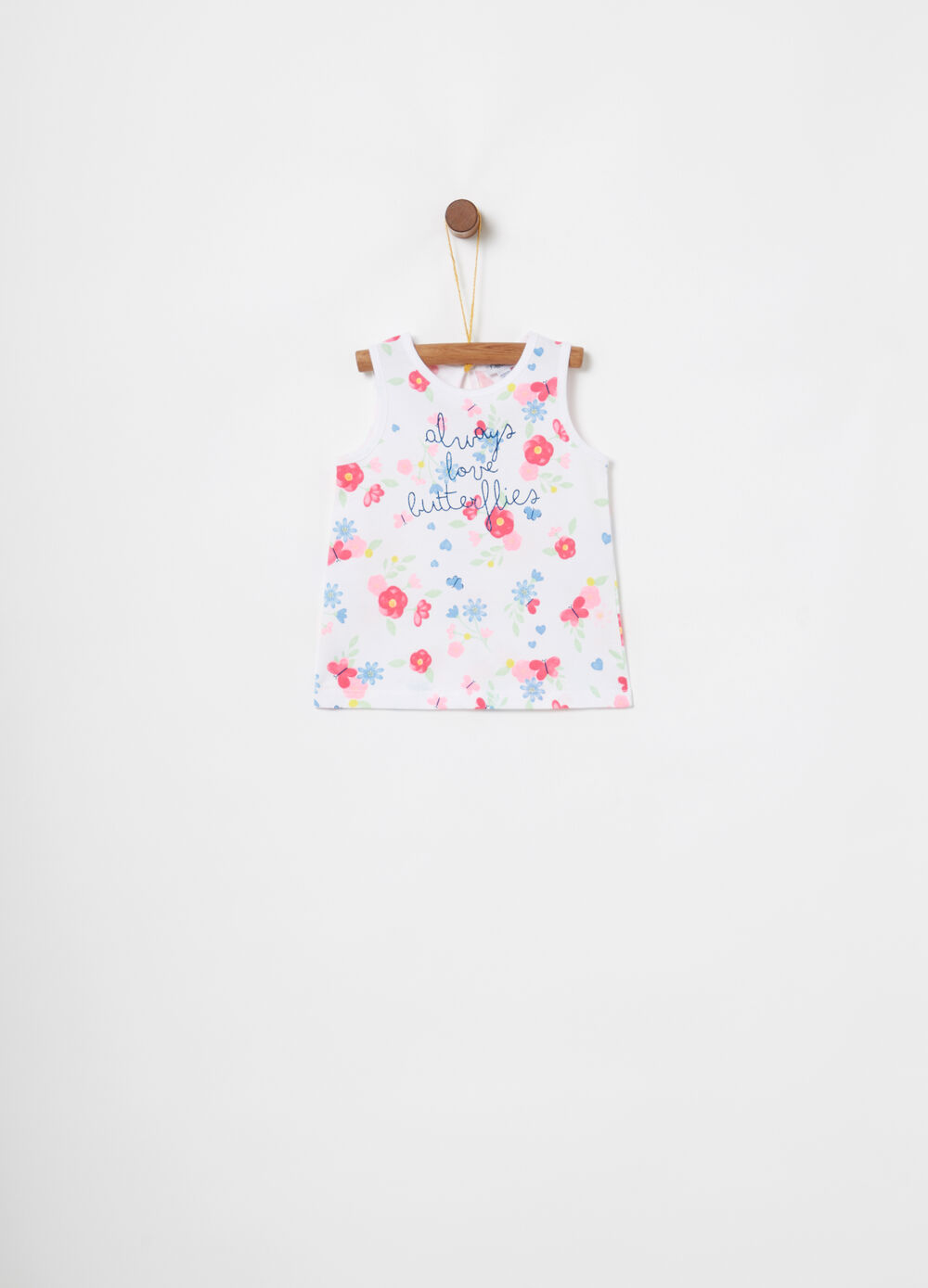 Vest with embroidery and floral pattern