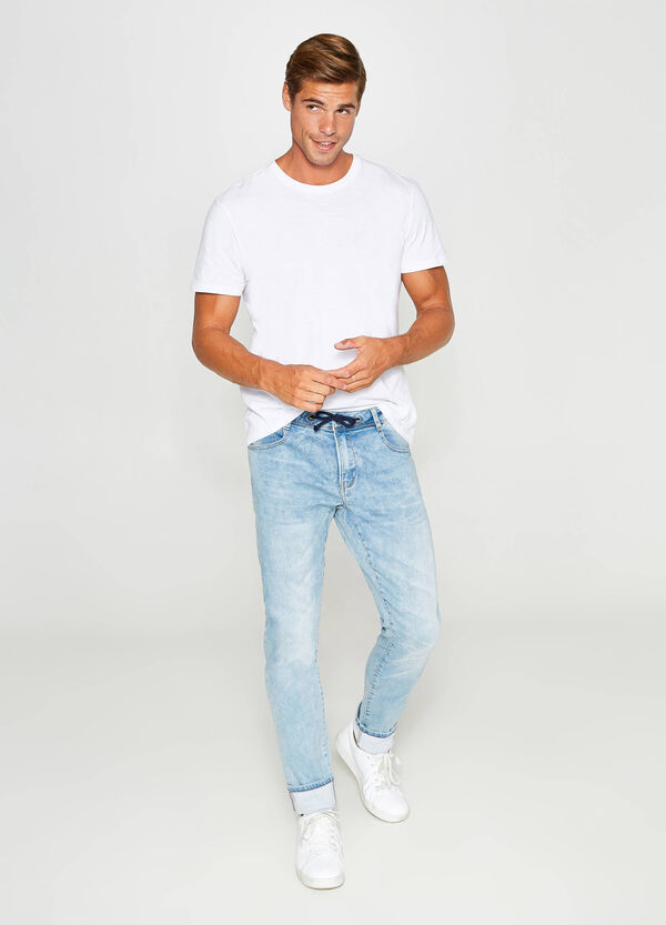 Worn-effect, slim-fit stretch jeans with drawstring