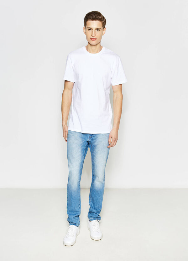 Slim-fit worn-effect jeans
