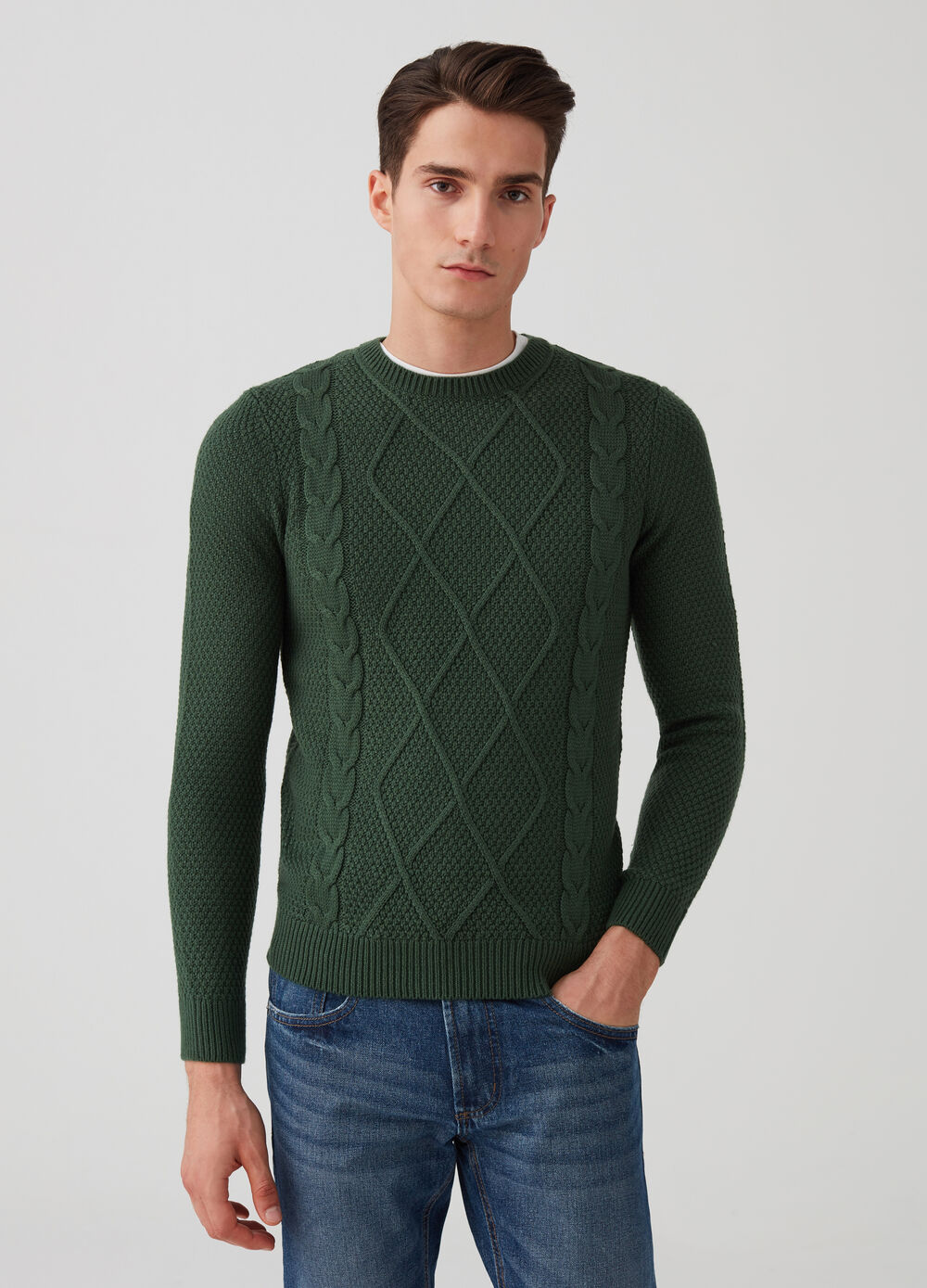 Knitted pullover with braided weave
