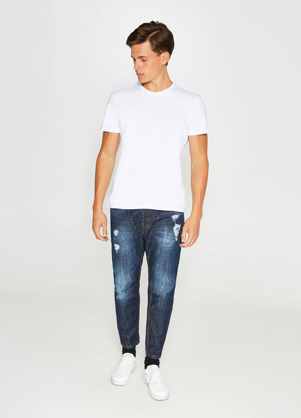 Loose-fit misdyed-effect jeans with abrasions
