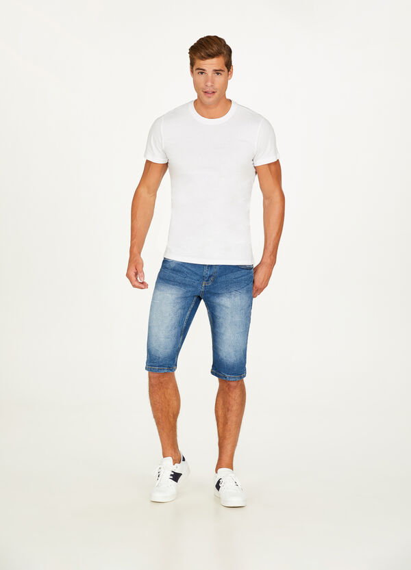 Worn-effect stretch and creased denim Bermuda shorts