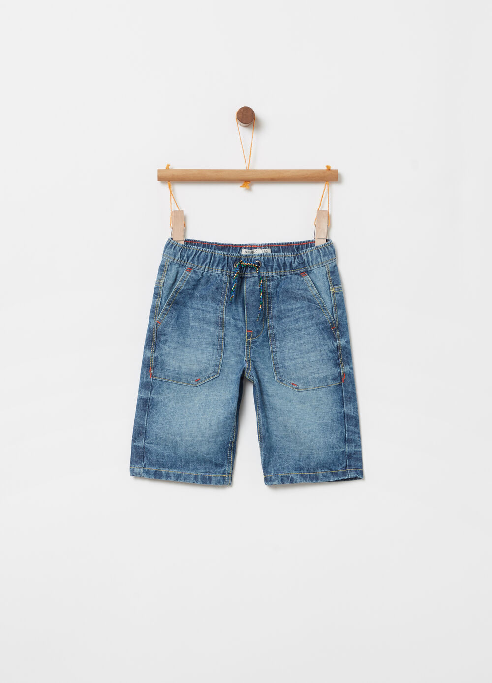 Washed denim shorts with functional pockets