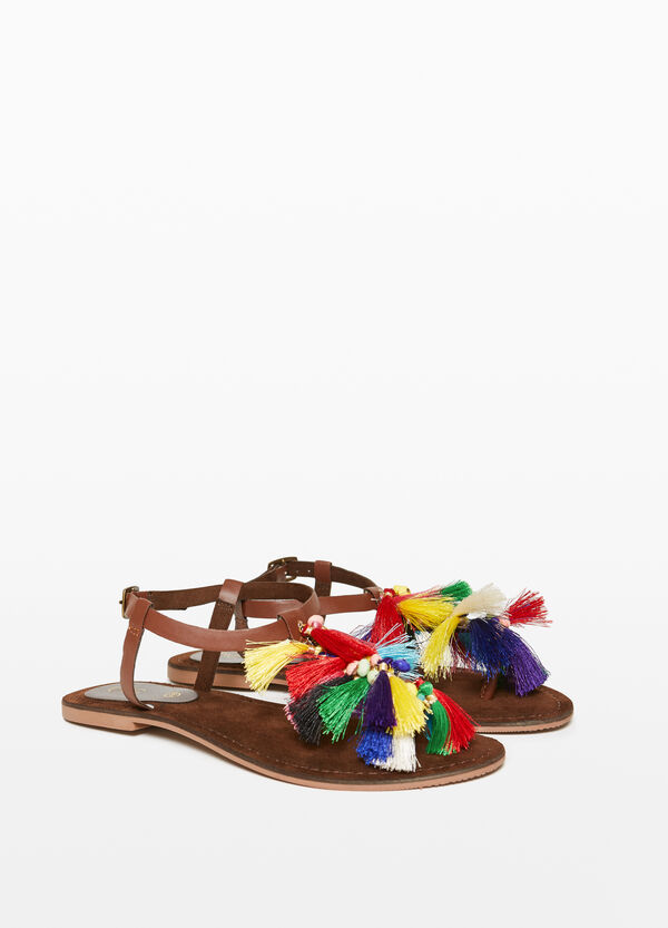 Thong sandals with stones and tassels