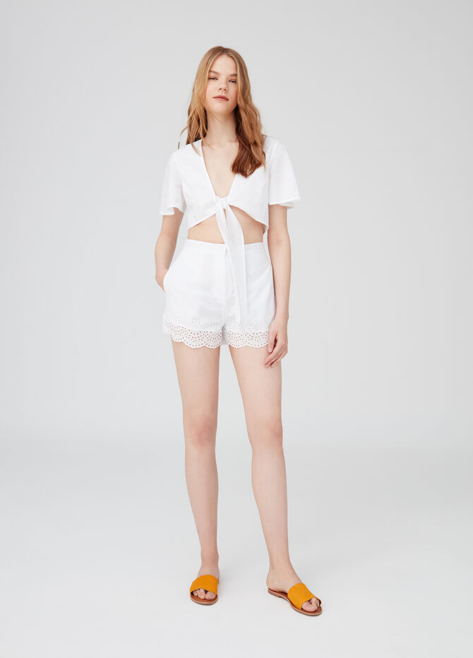 Shorts with pockets and openwork floral inserts