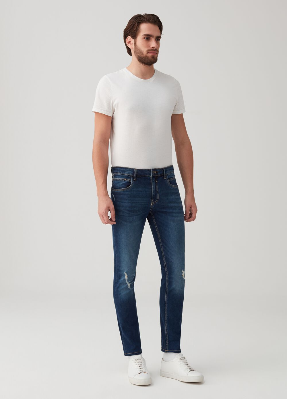 Worn-effect skinny-fit stretch jeans
