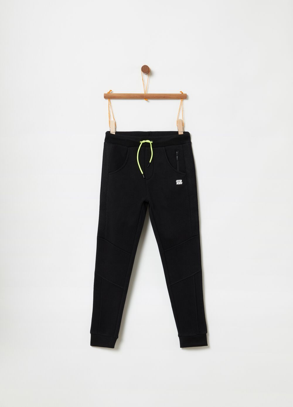 Trousers in French terry with mesh inserts
