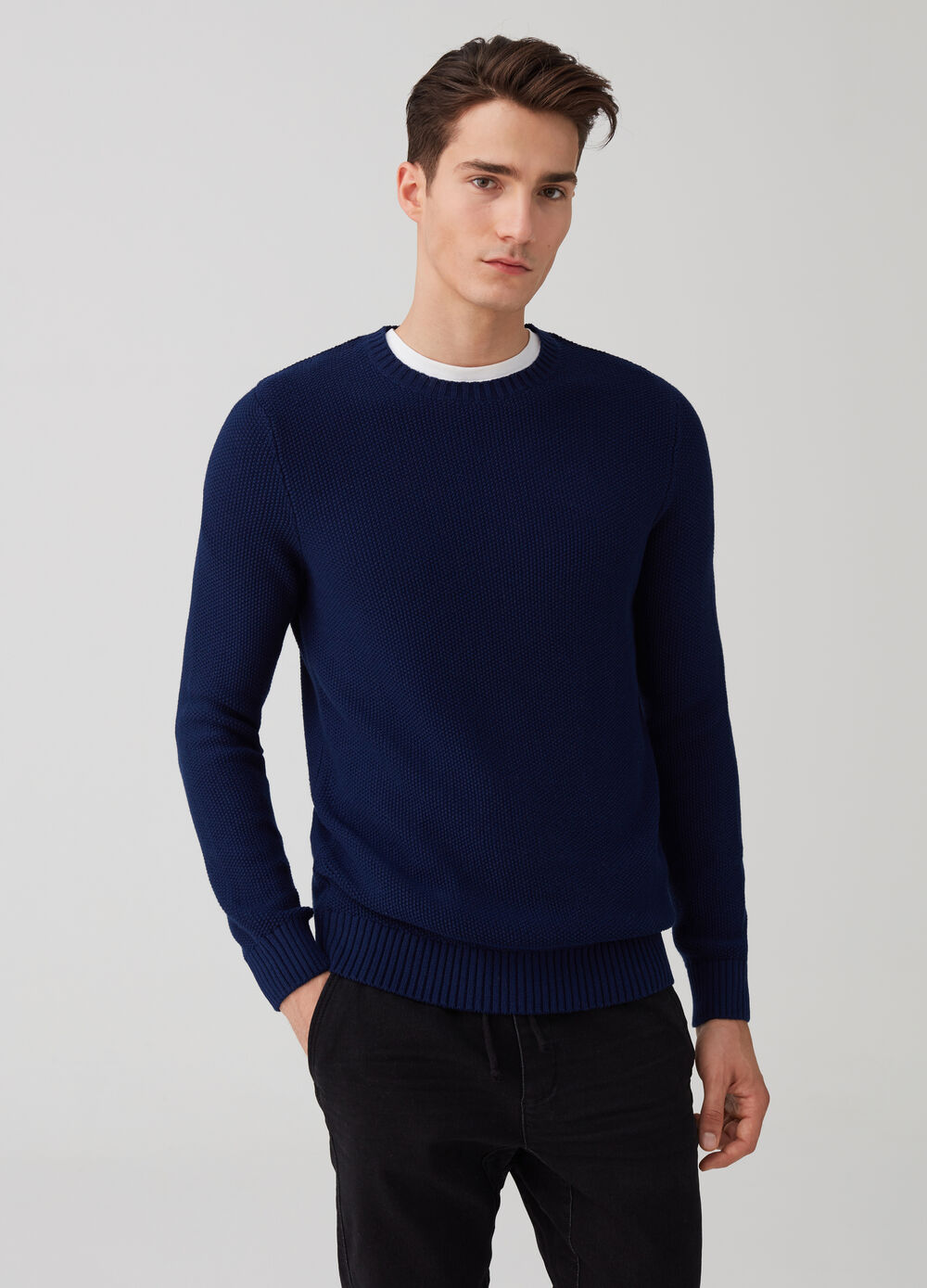 Knitted pullover with geometric weave and ribbing