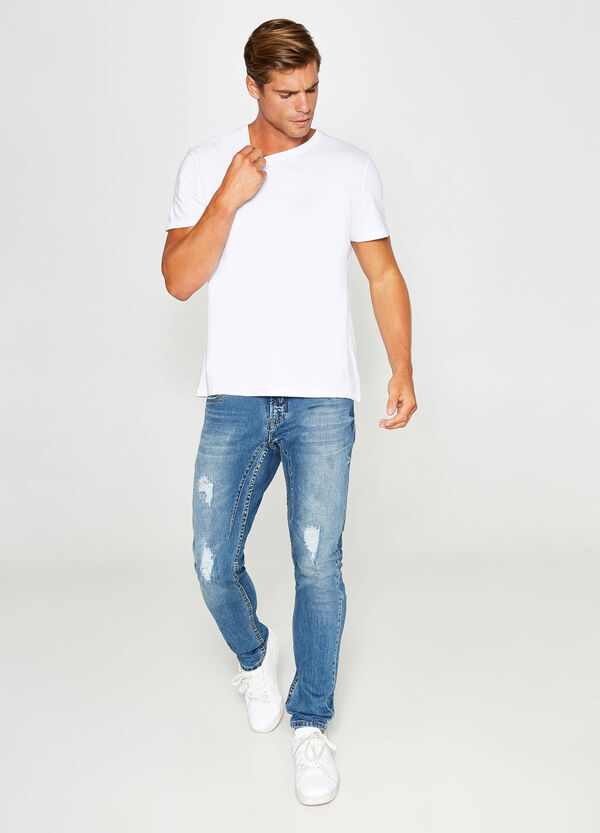 Worn-effect skinny-fit stretch jeans with small rips