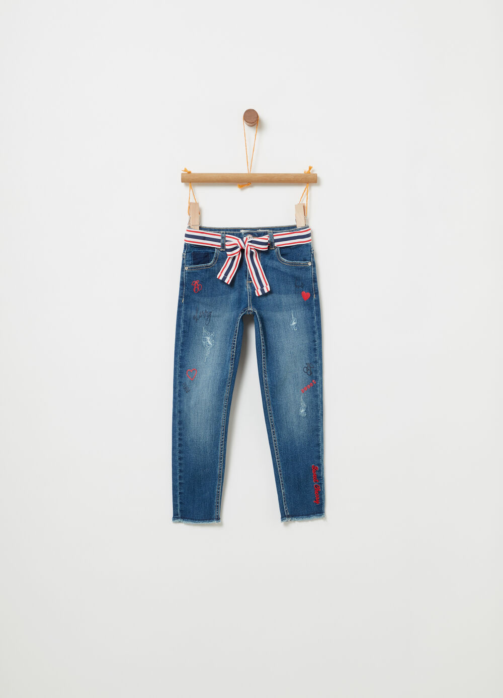 Stretch jeans with embroidery and fringed hem