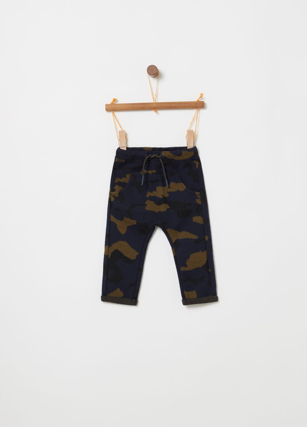 Trousers with low crotch and camouflage print
