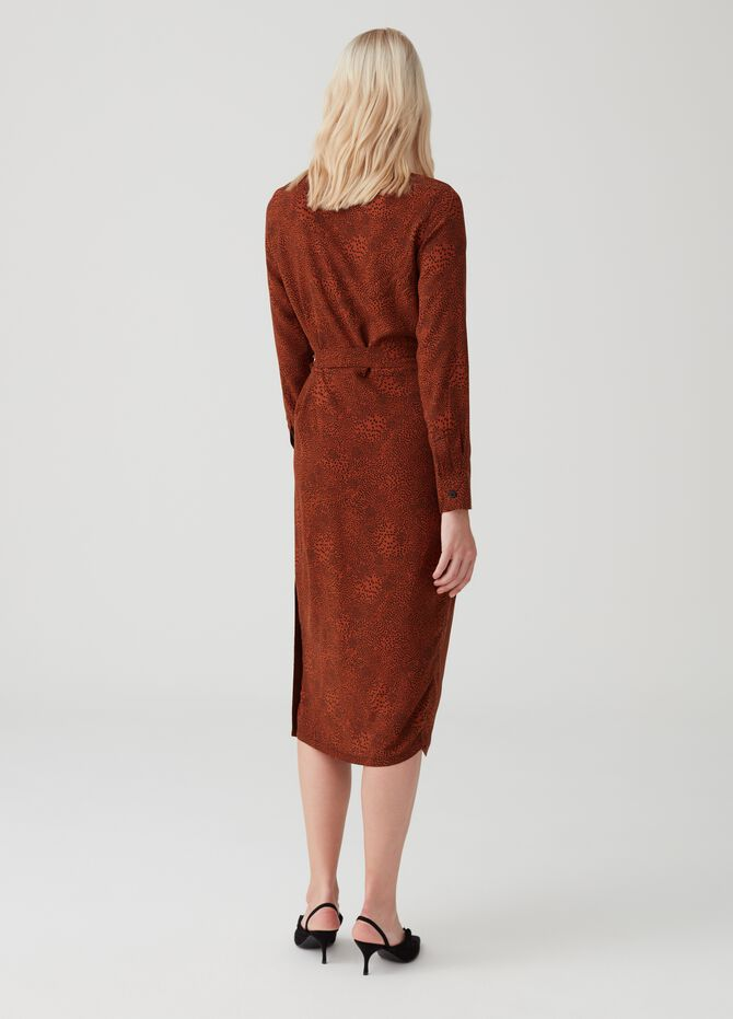 Crossover dress with fastening on the side