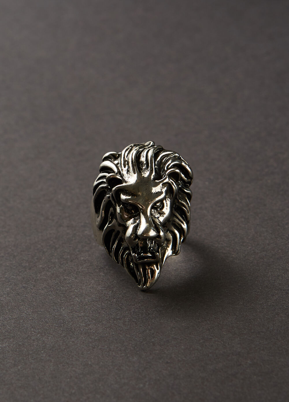 Steel ring with lion motif.