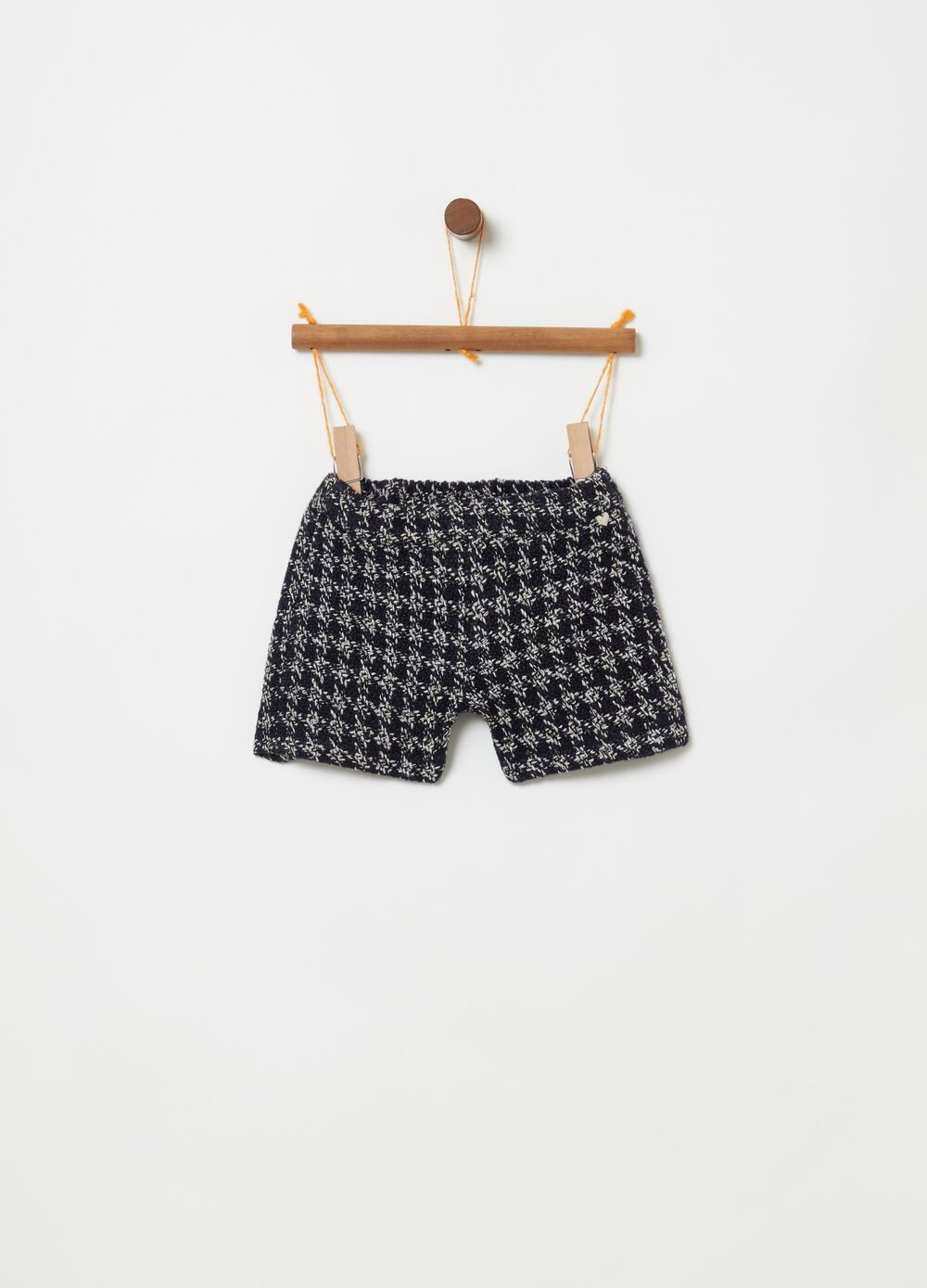 Shorts with hounds' tooth pattern