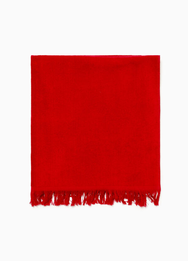 Solid colour beach towel in 100% cotton.