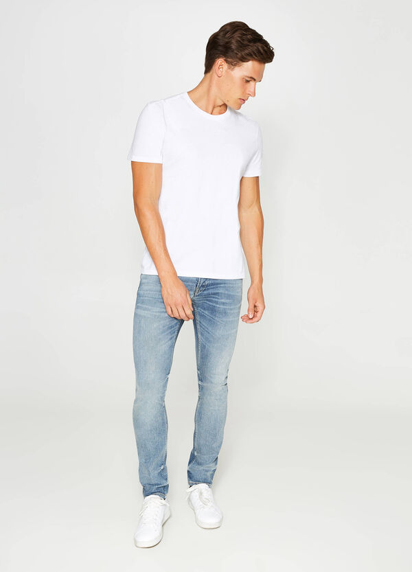 Slim-fit misdyed-effect stretch jeans with whiskering