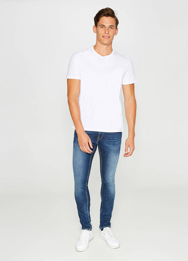 Worn-effect slim-fit stretch jeans with fading