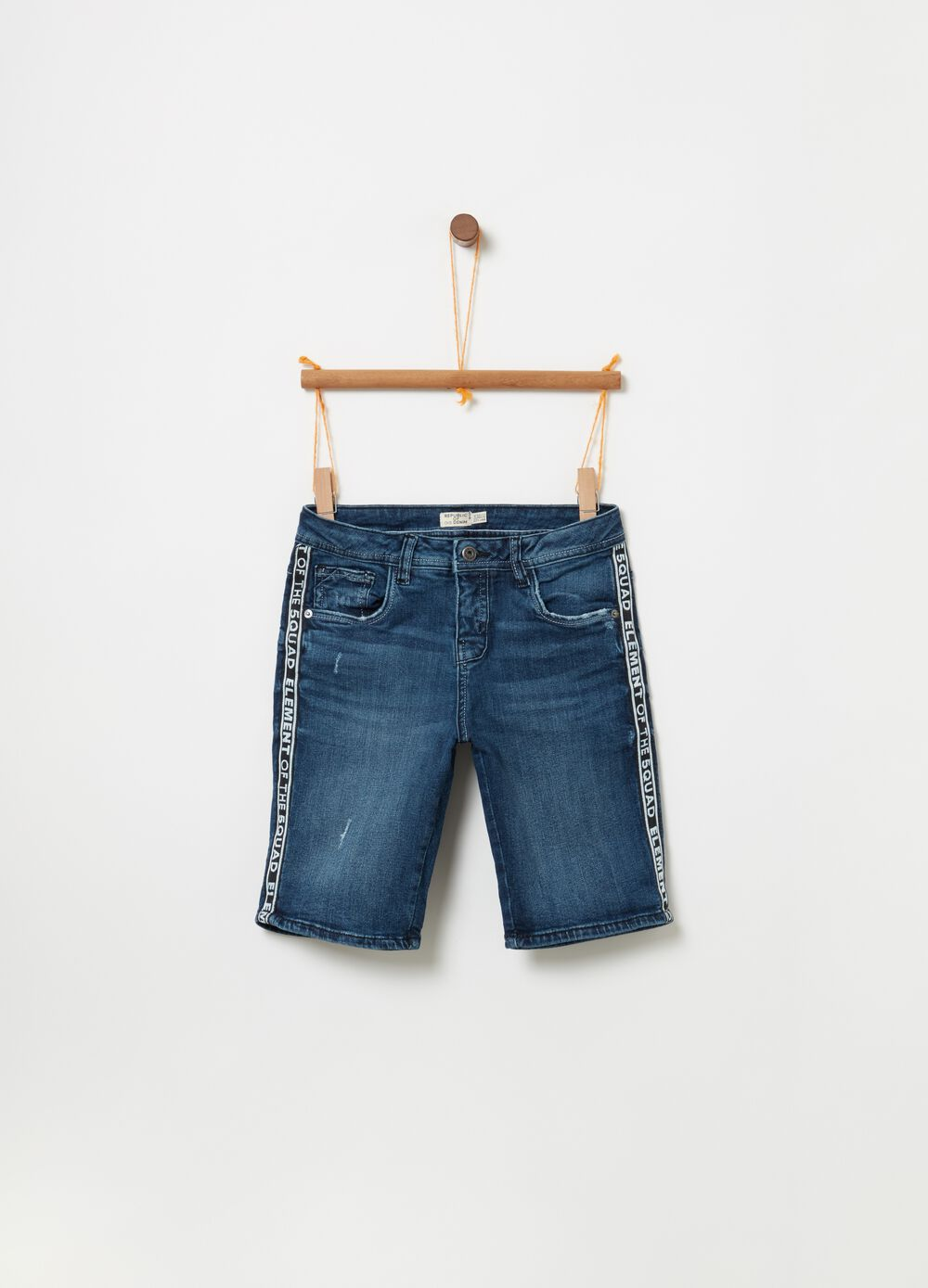 Stretch denim Bermuda shorts with washed effect