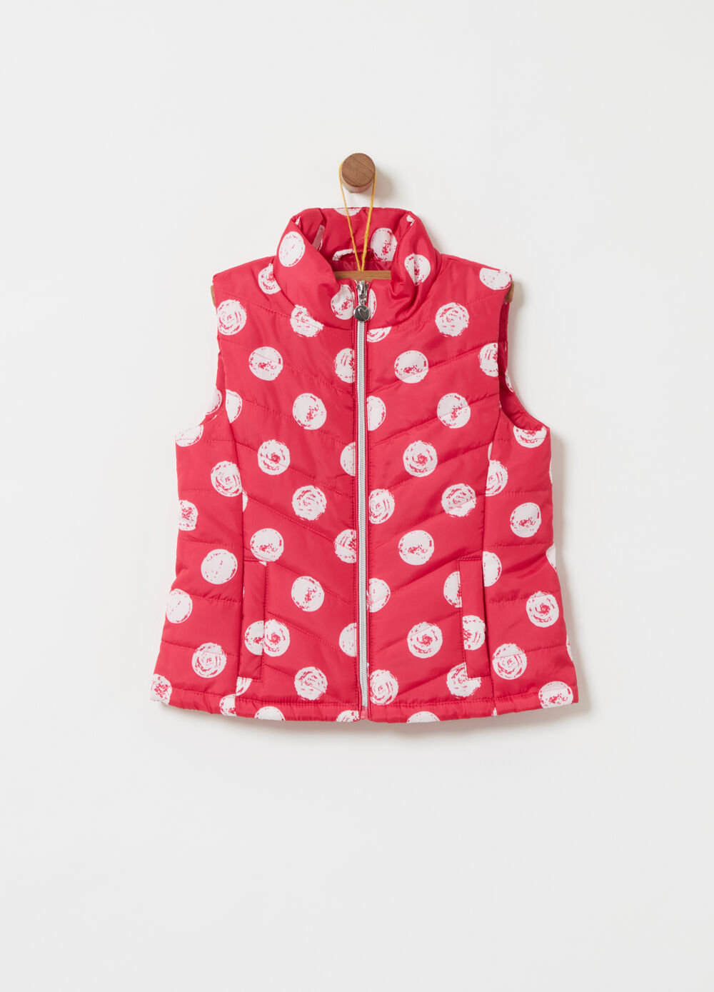 Padded gilet with high collar and polka dot pattern