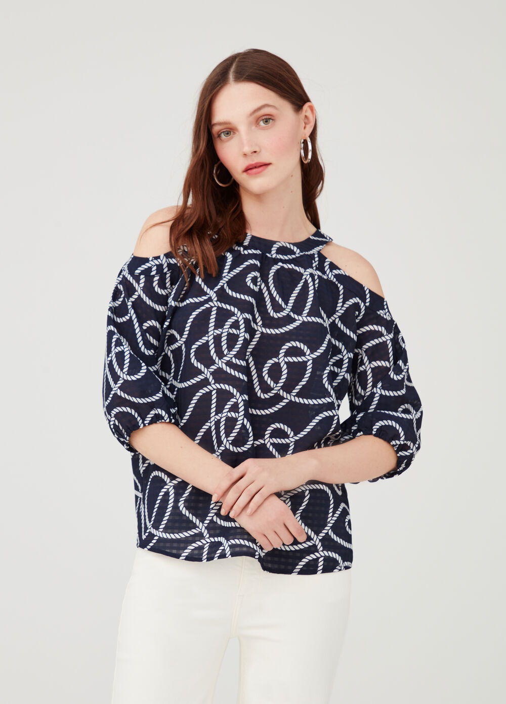 Blouse with opening on the shoulders and pattern