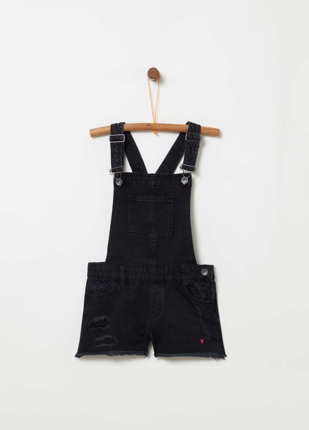 Worn-effect denim dungarees with animal print