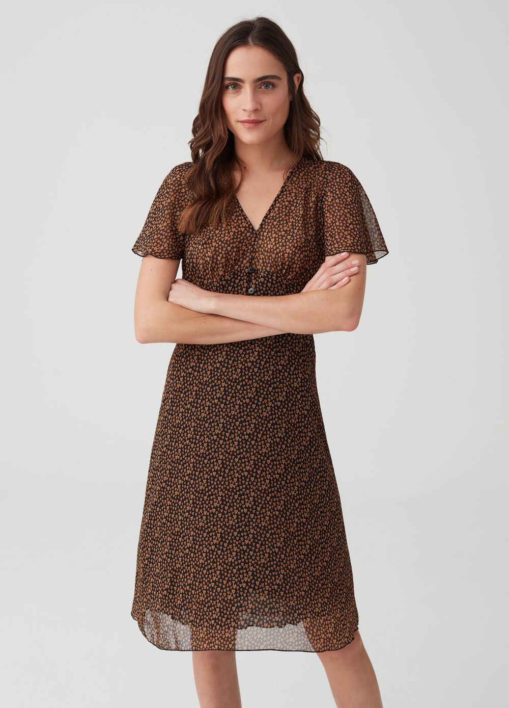 Dress with cap sleeves and V neck