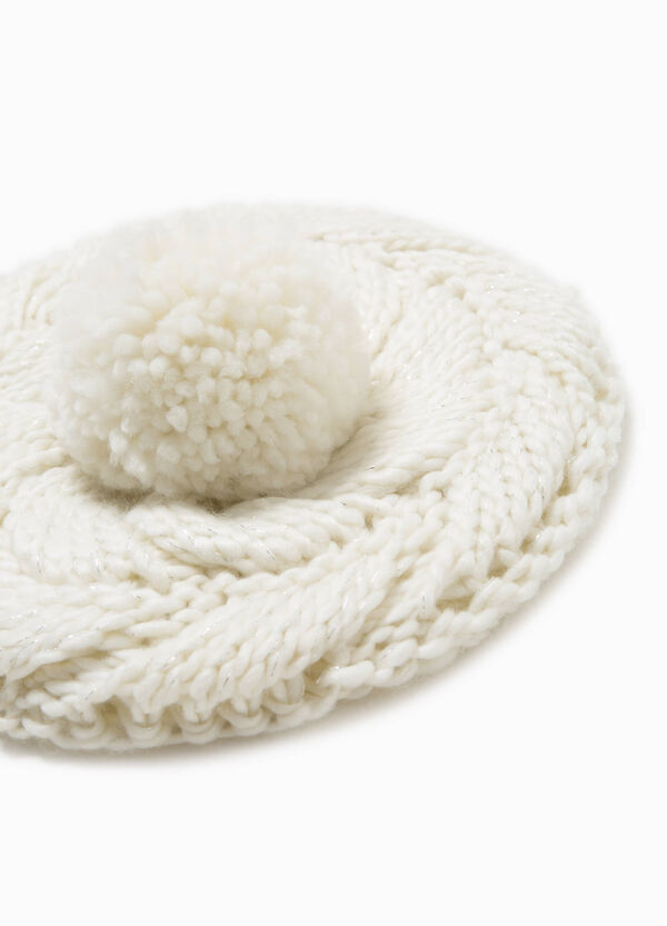 Knitted beret with pompoms