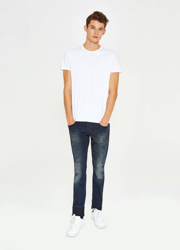 Worn-effect slim-fit stretch jeans with small rips