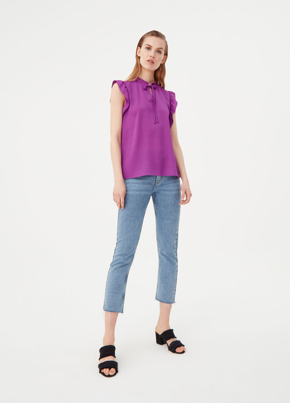 Sleeveless shirt with ruches