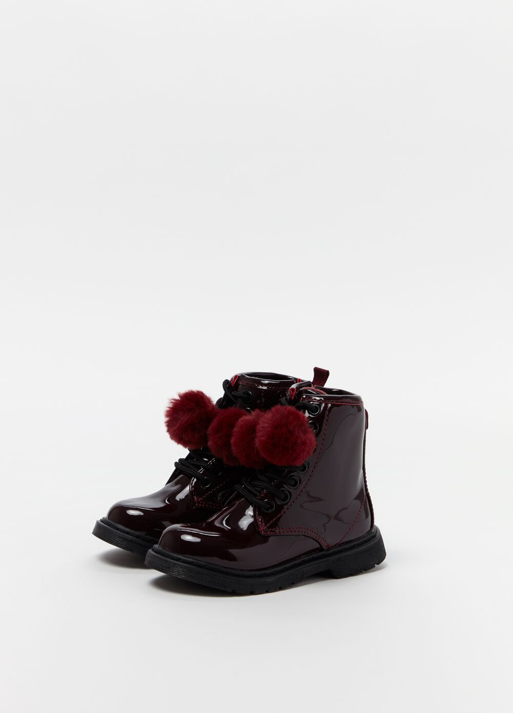 High boots with pompoms