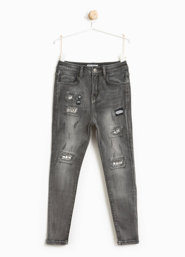 Worn-effect stretch jeans with rips | OVS
