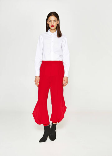 Stretch trousers with openings