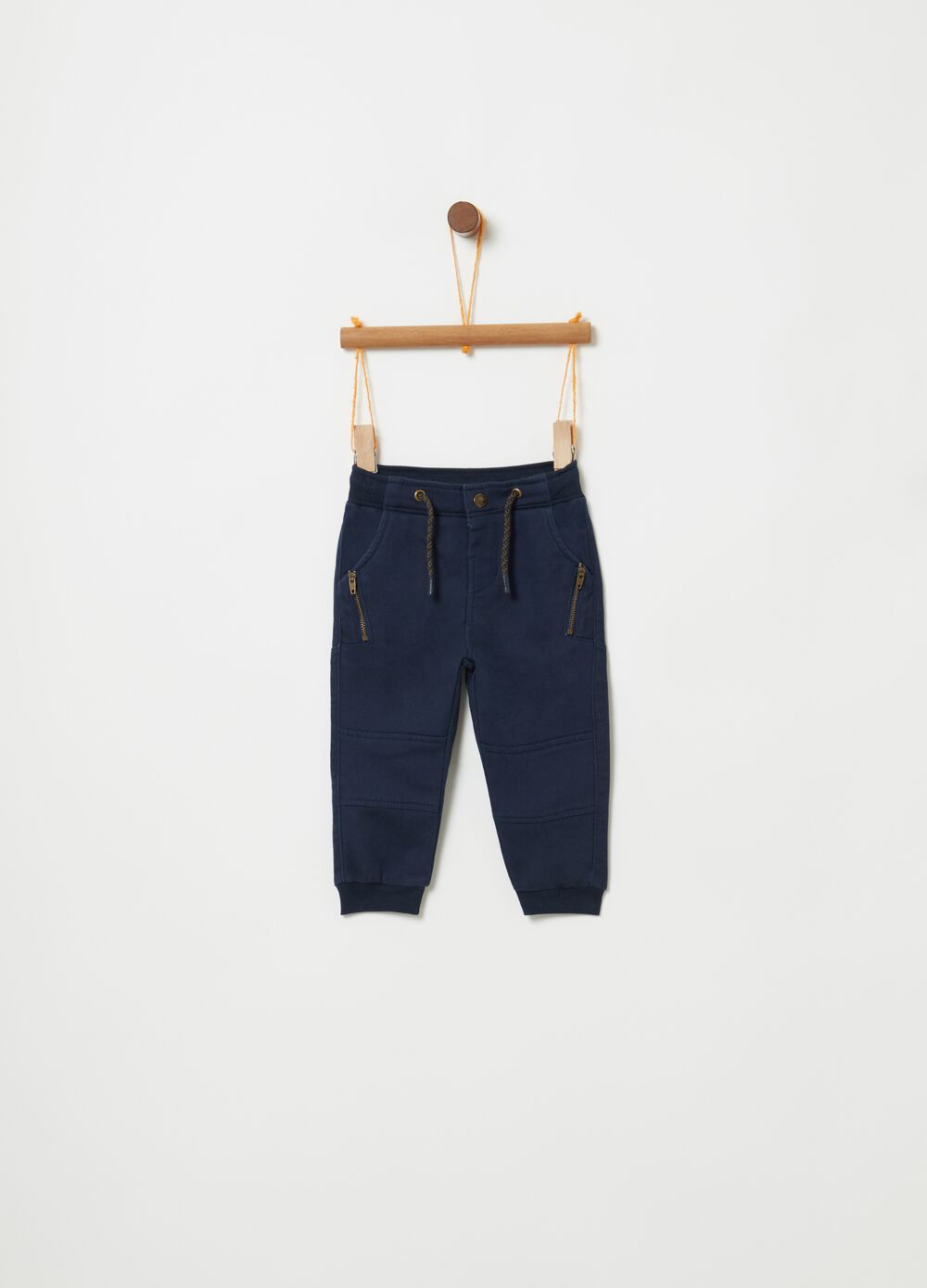 Trousers with drawstring, cuts and zip