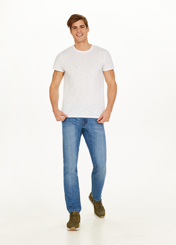 Washed-effect jeans with whiskering