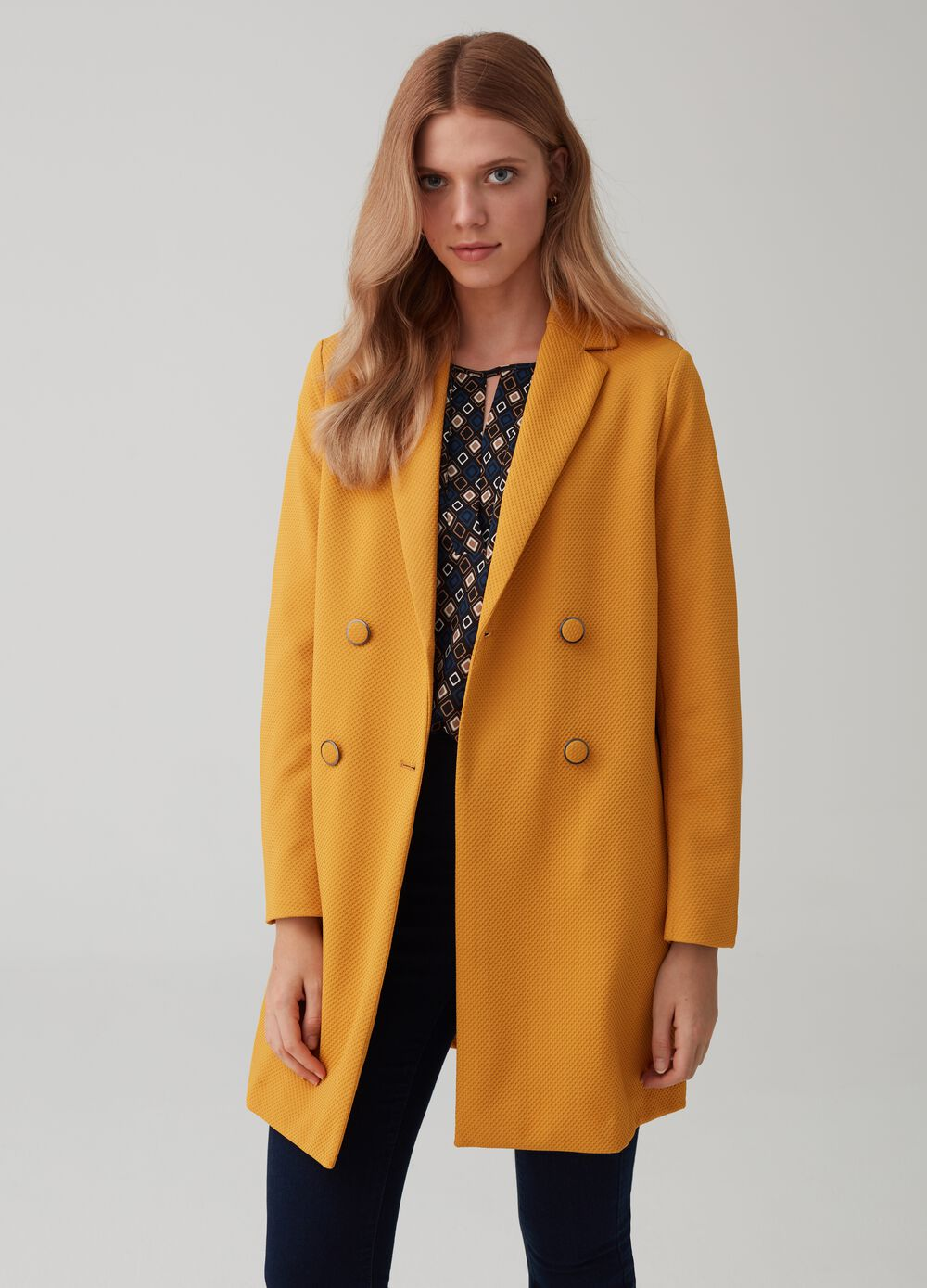 Piquet coat with lapels and pockets