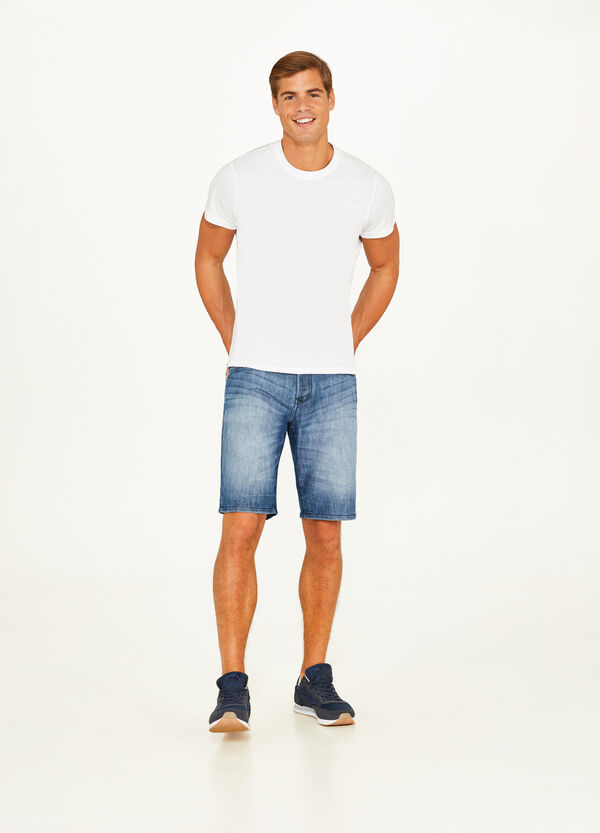 Denim Bermuda shorts with fading and whiskering