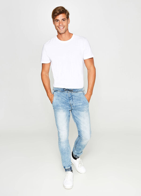 Loose-fit, misdyed and faded jeans