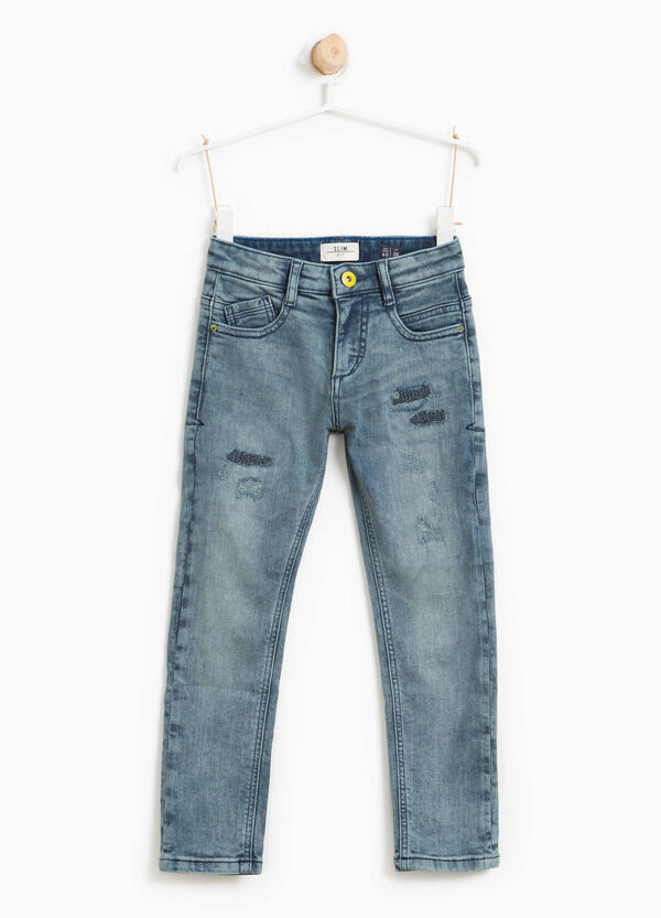 Worn-effect stretch jeans with abrasions | OVS