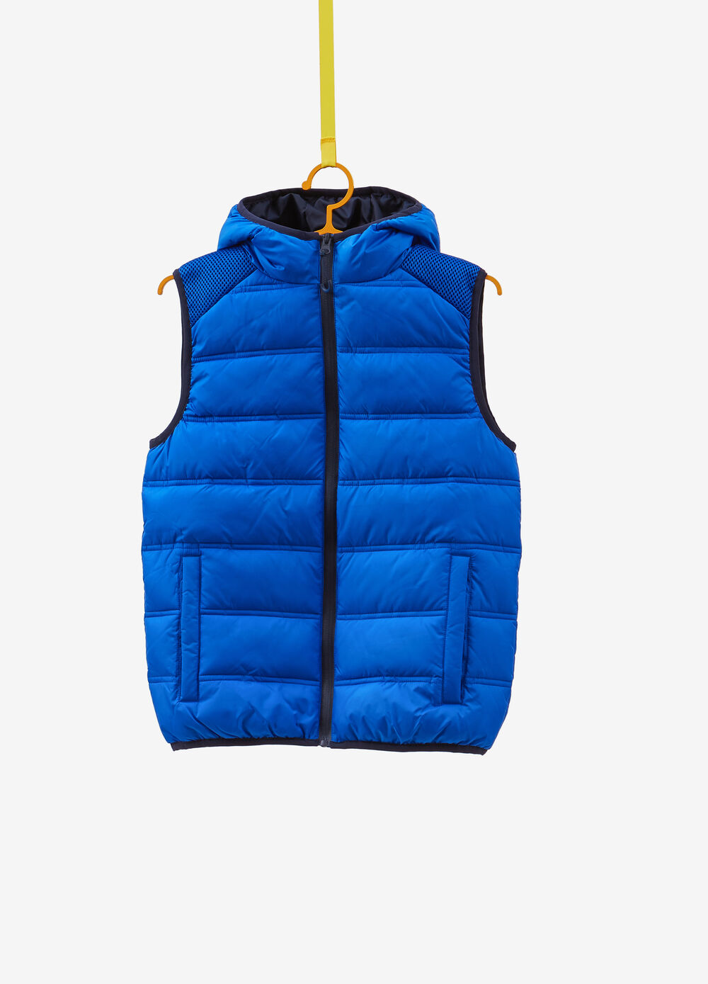 Gilet with trim and mesh inserts
