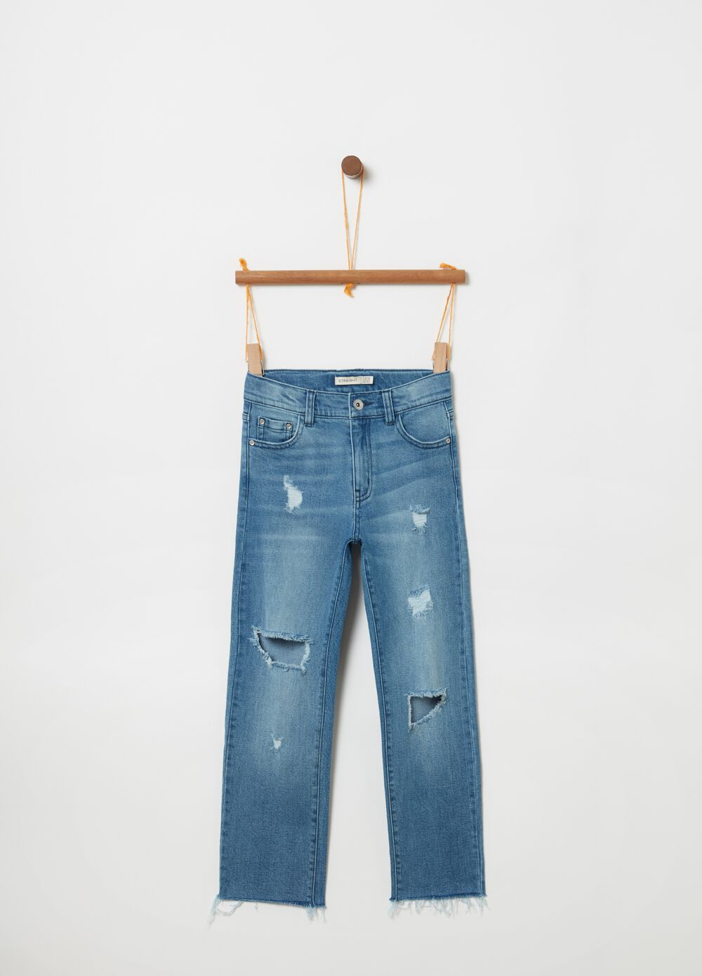 Faded jeans with five pockets and cuts