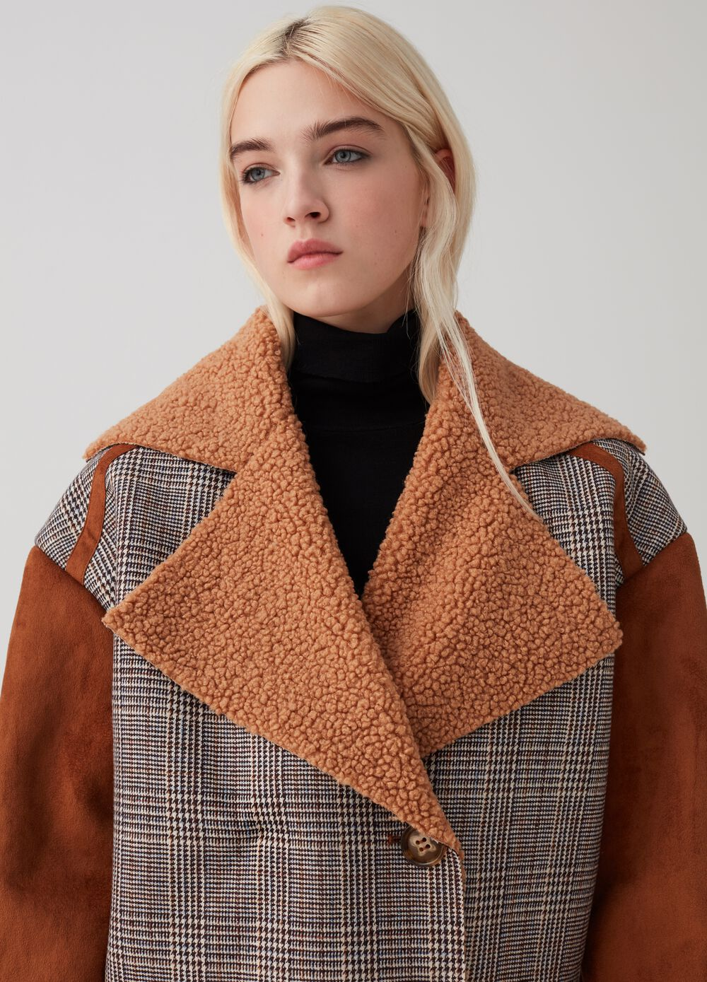 Sheepskin-effect jacket with raw edges