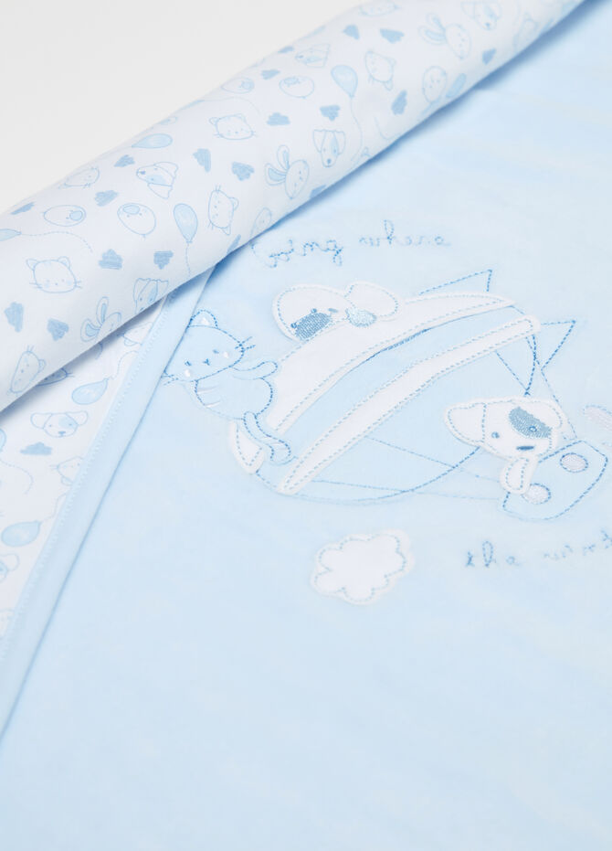 Chenille blanket with applications and embroidery