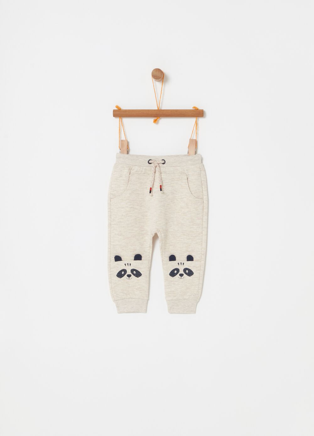 Quilted trousers with raccoon print
