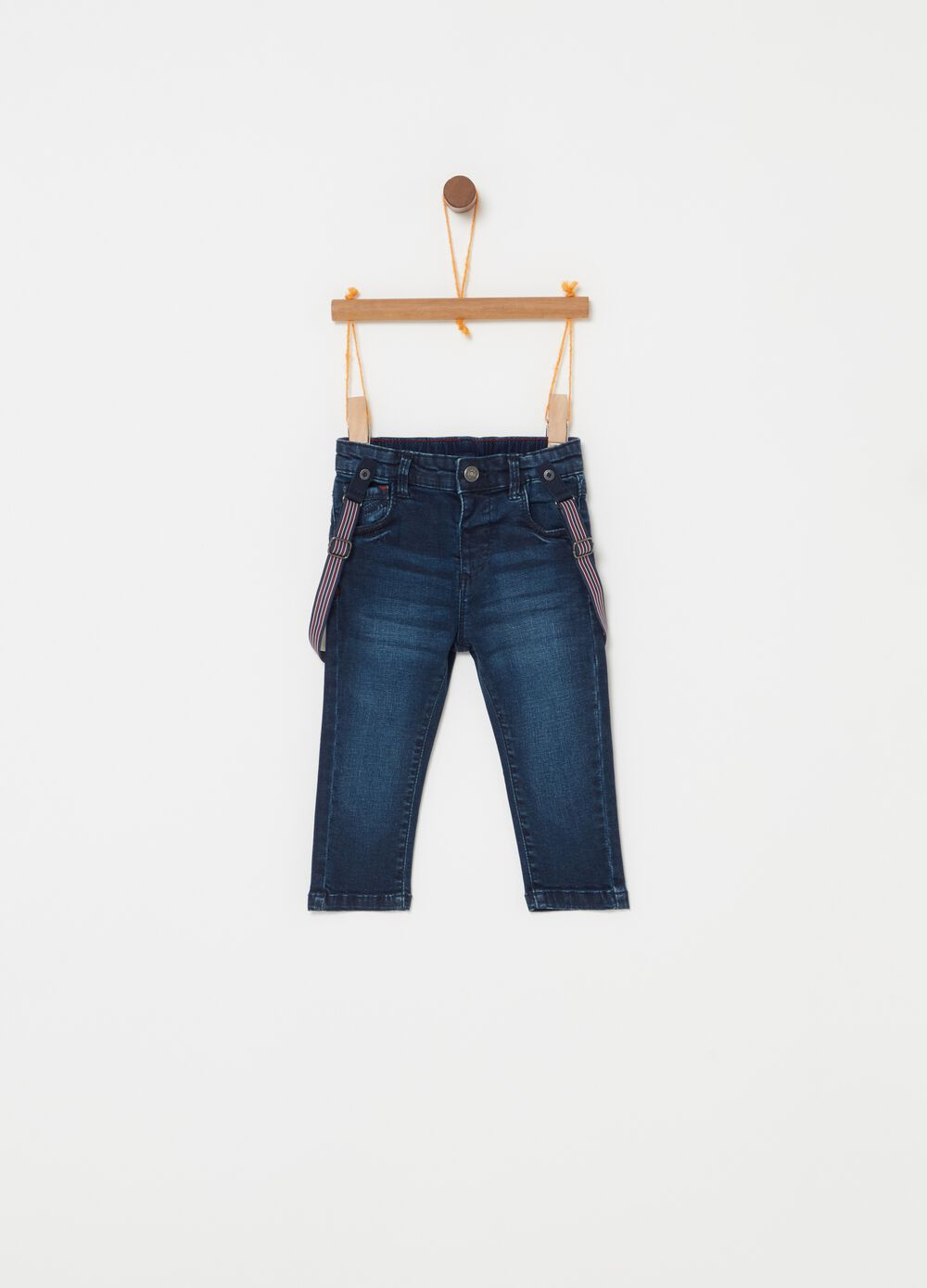 Worn-effect jeans with braces and five pockets